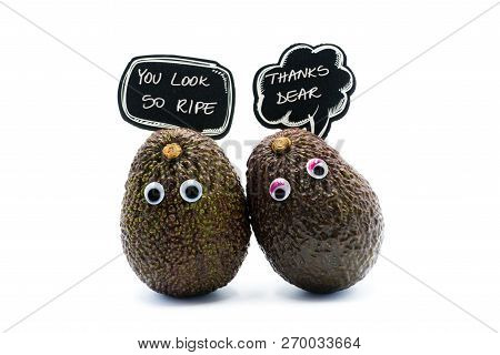 Romantic Avocados Couple With Googly Eyes And Speech Bubble As Man And Woman, Funny Food Concept For