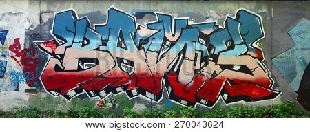 Full And Acomplished Graffiti Artwork. The Old Wall Decorated With Paint Stains In The Style Of Stre