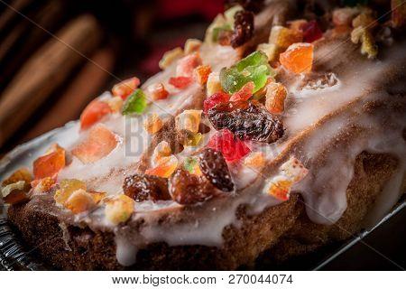 Christmas Homemade Fruitcake On The Wooden Background.