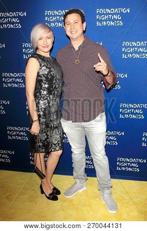 LOS ANGELES - NOV 17: Elena Dronova, DJ Beni Swift at the 2018 Emerald City Gala Visionary Awards Dinner at the Bel Air Country Club on November 17, 2018 in Los Angeles, California