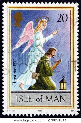 Isle Of Man - Circa 1997: A Stamp Printed In Isle Of Man Shows Angel And Shepherd, Christmas, Circa