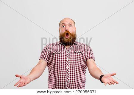 Man with beard waving hands
