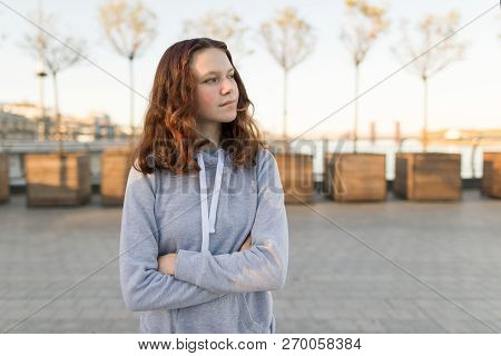Outdoor Portrait Of A Beautiful Smiling Teenager Girl 14, 15 Years Old, Golden Hour