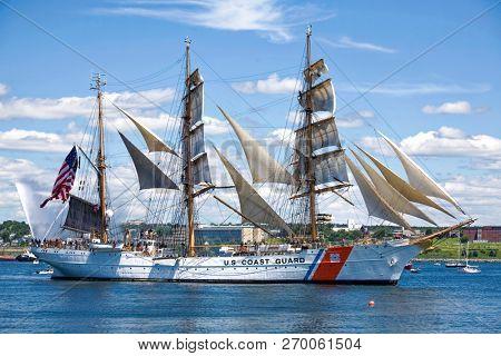 HALIFAX, NOVA SCOTIA, CANADA - AUG 20, 2009:  The U.S. Coast Guard ship, the Eagle, sailing in Halifax Harbour during the Tall Ships Festival.