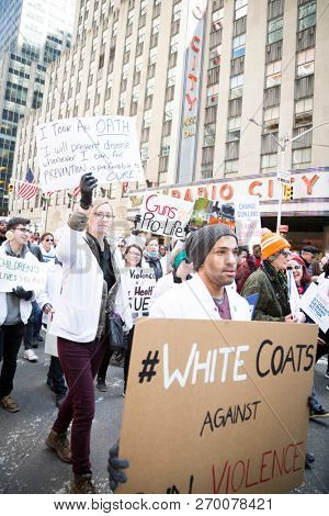 March For Our Lives: Medical professionals with White Coats Against Gun Violence protest in the march to end gun violence, on 6th Ave NEW YORK MAR 24 2018.