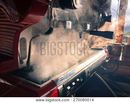 Coffee Maker Machine And Hot Steam ,selective Focus With Copy Space For Product Advertising Backgrou