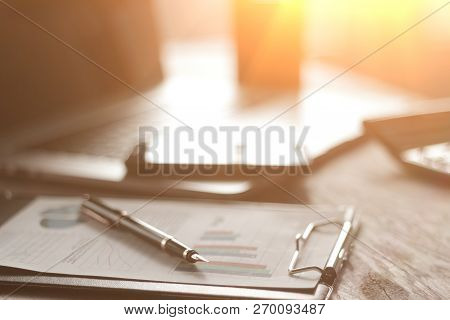 Close Up.clipboard And Fountain Pen On The Desktop Of The Busine