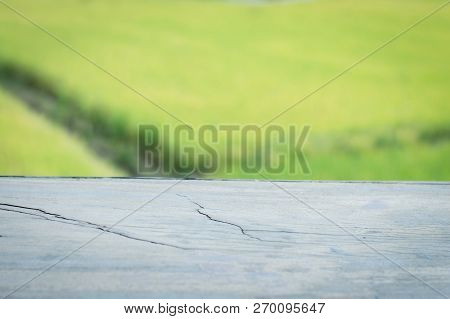 Wooden Table Surface With Abstract Blurred Background For Product Display Montage,can Be Used For Mo