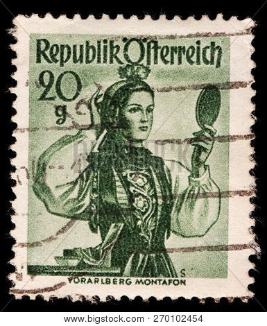 Luga, Russia - January 31, 2018: A Stamp Printed By Austria Shows Beautiful Woman In National Dress