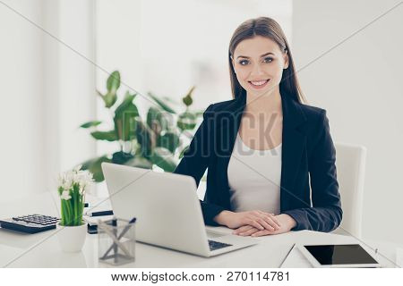 Beautiful attractive adorable charming cheerful classy chic elegant lady wearing black jacket in front of laptop at light white modern workplace workstation poster