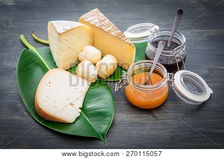 Mixed Cheese With Jam Fruit On Green Leaf