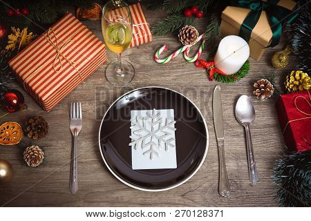 Merry Christmas And Happy New Year. Dinner Plate Setting On Wood Table Top View.