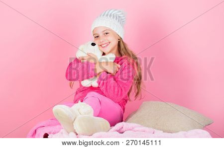 Teddy bears improve psychological wellbeing. Kid cute girl play with soft toy teddy bear pink background. Child small girl playful hold teddy bear plush toy. Unique attachments to stuffed animals poster