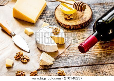 Red Wine With Cheese And Honey On Wooden Background