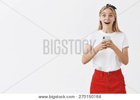 Girl Got Part In Play, Being Amazed And Surprised Receiving News Via Smartphone. Portrait Of Thrille