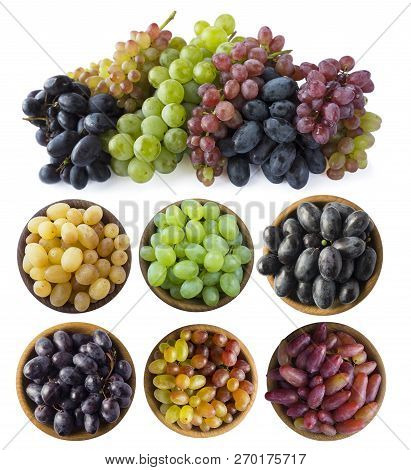 Mixed Grapes Of Different Varieties. Grapes In A Wooden Bowl Isolated On White Background. Blue, Yel