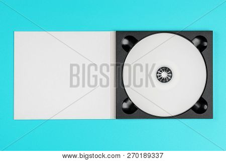 White Cd In Black Case On Pastel Green Background