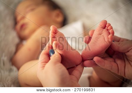 Beautiful Infant Baby Feet In Mother Hands. Feet Of Little Baby Boy, Newborn Baby Foot, Newborn Baby