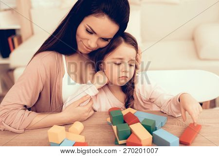 Mom Teaches Daughter. Educational Games. Learning Child At Home. Build House Of Cubes. Woman And Sad