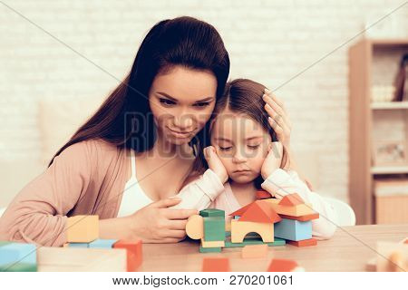 Mother Teaches Daughter. Educational Game. Learning Child At Home. Build House Of Cubes. Woman And S