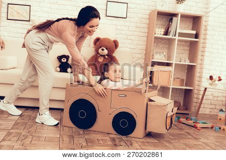 Kids Home Games. Child Development. Mom And Daughter Play. Happy Mom And Child Playing Car. Woman An
