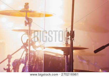 Live Rock Music Photo Background, Rock Drum Set  With Cymbals In Bright Strobe  Lights. Close-up Pho