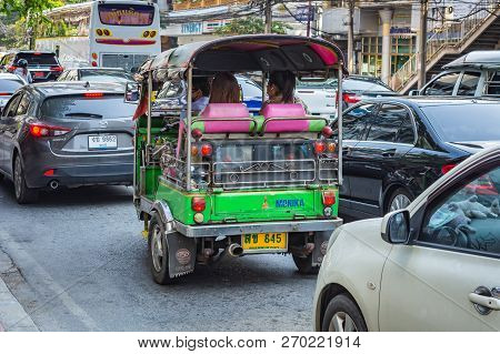Bangkok, Thailand - November 2018: Auto Rickshaw (tuk-tuk) With Passengers On The Street In The Sunn