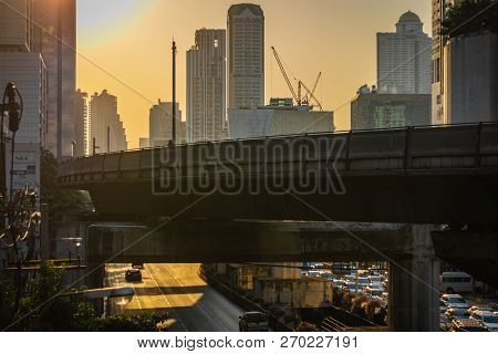Bangkok, Thailand - November 2018: Orange Sunset Over The Street Of Bangkok And The Skytrain Railroa