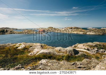 Sea Landscape Of A Rocky Coastline And A Small Town On The South Of Sweden. Southern Coastline Of Sw