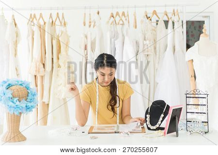 Portrait Of Asian Woman Wedding Dress Store Owner,beautiful Female Dressmaker In Shop And Small Busi