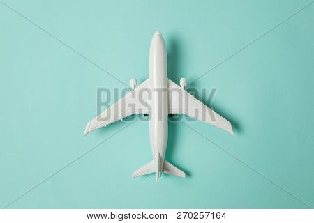 Simply Flat Lay Design Miniature Toy Model Plane On Blue Pastel Colorful Paper Trendy Background. Tr