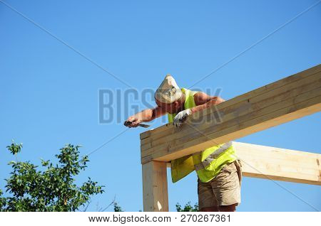 Kyiv, Ukraine - December, 04, 2018:   Roofer Contractor Building House Roof Beams, Trusses, Wooden F