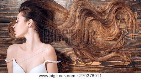 poster of Beauty hair Salon. Woman with long beautiful hair. Fashion haircut. Beauty girl with long and shiny wavy hair. Trendy haircuts. Long healthy hair.