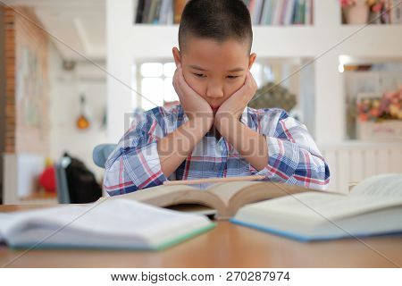 Little Asian Kid Boy Child Stressed Tired Frustrated Bored From Studying. Children With Unhappy Expr