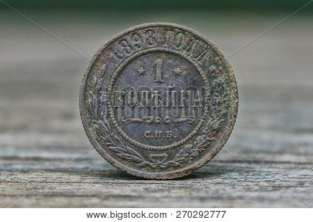 Old Gray Russian Coin One Kopek On The Table