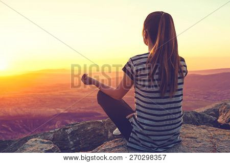 A Girl On Top Of A Hill In Silence And Loneliness Admires A Tranquil Natural Landscape In Search Of