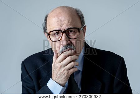 Portrait Of Older Adult Man With Sad And Worried Expression Suffering From Depression