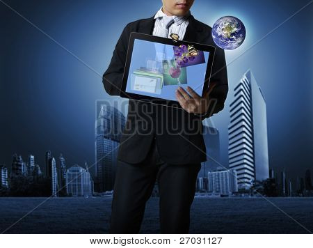 Businessman holding a touchpad