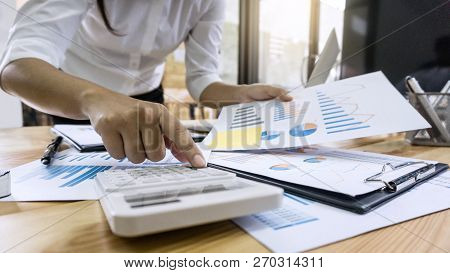 Business Woman Accountant Working And Calculating Financial Data On Graph Documents, Doing Finance I