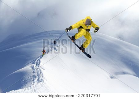 Skiers climbing a snowy mountain
