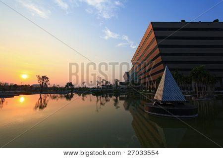 BANGKOK - DEC 20 : sunset at Government Complex shines at Dusk in Bangkok Thailand on Dec 20.2010 in Bangkok. Government Complex has 34 government units located at Chaeng Wattana St. in Bangkok.