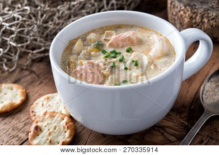 A Cup Of Delicious Homeade Seafood Chowder With Salmon, Haddock, Scallops, Clams And Shrimp.