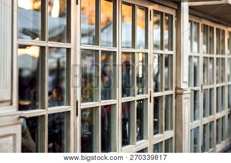 Panoramic Wooden Windows Showcase A Cafe Shop In Retro Style, The Window Frame Made Of Wood Is A Clo
