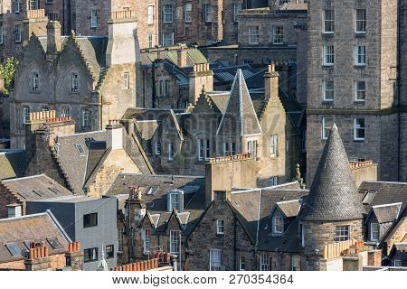 View Medieval City Of Scottish Edinburgh With Rooftops And Chimneys