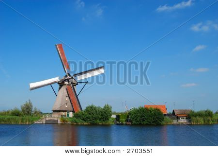 Dutch Mill On The Waterside