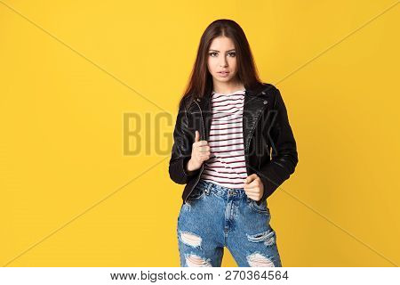 Fashion Girl Wearing Glam-rock Style Leather Jaket On Yellow Background, Copy Space