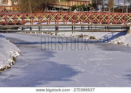 Frozen Brook With Small Bridge,here In Town Luhacovice