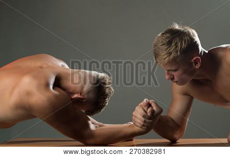 Trying strength. Twins competitors arm wrestling. Men competitors try to win victory or revenge. Twins men competing till victory. Strength skills. Revenge in sport. poster