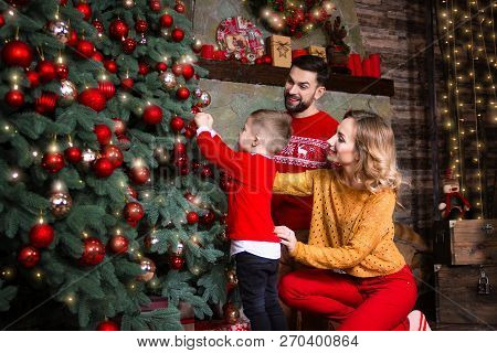 Merry Christmas And Happy New Year Concept. Happy Family: Mother Wife Woman, Father Husband Man And