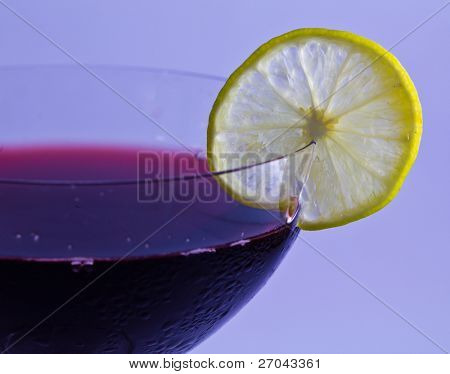 glasses of red wine  with lemon